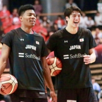 Japan's Avi Koki Schafer (right) stands with Rui Hachimura during a practice before an exhibition against South Korea at Ota City General Gymnasium in 2018. | KAZ NAGATSUKA