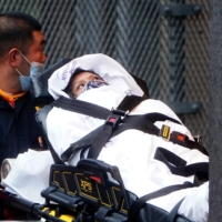 A patient is wheeled into the hospital amid the coronavirus pandemic in the Manhattan borough of New York City on Friday. | REUTERS