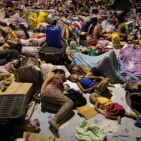 Residents affected by the onslaught of Typhoon Vamco sleep at a basketball court turned into an evacuation center, in San Mateo, Philippines, on Saturday.  | REUTERS