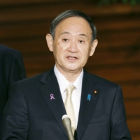 Prime Minister Yoshihide Suga speaks to reporters after holding a series of talks online with Asia-Pacific leaders, at the Prime Minister's Office on Saturday. | KYODO