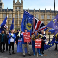 Pro-EU, anti-Brexit demonstrators protest outside of the Houses of Parliament in London in 2018.  | AFP-JIJI