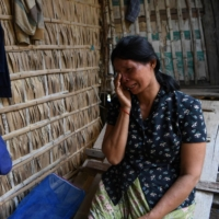 Roeurm Reth, who owes huge microfinancing debts, at her house in a village in Siem Reap province, Cambodia.The farmer fears she will have to sell her land to repay microfinance loans that have ballooned due to pandemic-spurred job losses in her family.  | AFP-JIJI