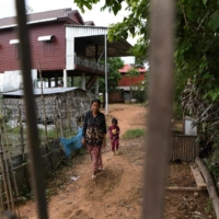 Penh Tay's new house in Siem Reap province was built through microfinancing with huge unpaid loans.  | AFP-JIJI
