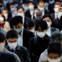 Over 80% of respondents are concerned about a recent spike in coronavirus cases in Japan, a survey shows.  | REUTERS