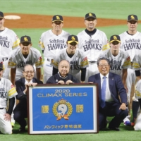 The Hawks pose for a team photo after advancing to the Japan Series with a PL Climax Series-clinching win over the Marines on Sunday in Fukuoka. | KYODO