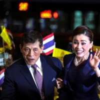 Thailand's King Maha Vajiralongkorn and Queen Suthida greet royalists as they inaugurate a new subway station on the outskirts of Bangkok on Saturday.    REUTERS