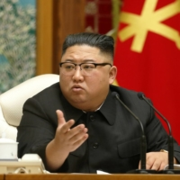 North Korean leader Kim Jong Un speaks at the recent 20th Enlarged Meeting of the Political Bureau of the 7th Central Committee of the Workers' Party of Korea. | KCNA / VIA REUTERS