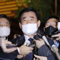 Kim Jin-pyo speaks to reporters at the Prime Minister's Office after meeting Prime Minister Yoshihide Suga on Friday. | KYODO
