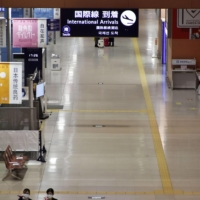 An arrival lobby for international flights at Kansai International Airport in Osaka Prefecture is deserted on Nov. 4. | KYODO
