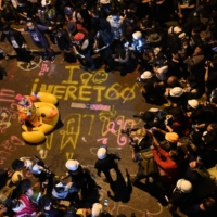 Members of the media take pictures of a clown on an inflatable oversized duck as pro-democracy protesters take part in an anti-government rally in Bangkok on Wednesday.  | AFP-JIJI