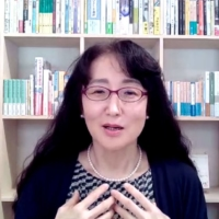 Writer Yu Miri speaks in an online press conference Thursday after winning the prestigious National Book Award for translated literature. | KYODO