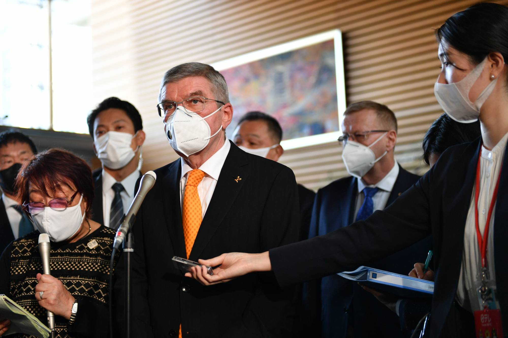 The 2020 Olympic and Paralympic Games will be 'a light at the end of the tunnel,' said Thomas Bach, president of the International Olympic Committee, speaking to reporters Monday. | RYUSEI TAKAHASHI