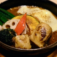 Pig out: Soup Curry Garaku's pork belly is charred, tender and laced with just the right amount of fat. | FLORENTYNA LEOW