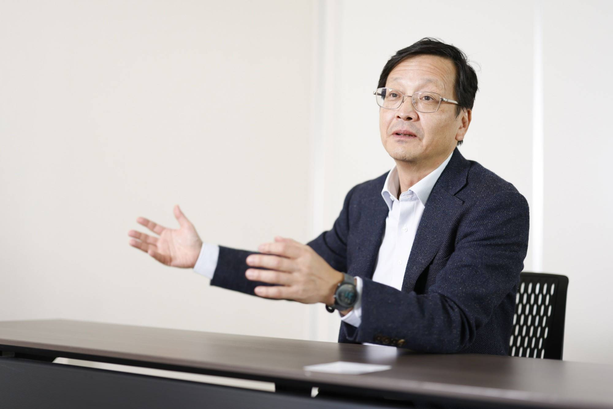 Hitoshi Oshitani, a virologist and infectious disease specialist, speaks during an interview in Tokyo in October. | BLOOMBERG