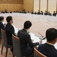 Members of the National Governors' Association attend a government-sponsored meeting on the coronavirus pandemic at the Prime Minister's Office on Friday. | KYODO