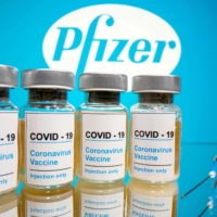 U.S. biotech giant Pfizer and German partner BioNTech sought approval Friday to roll out their coronavirus vaccine early, a first step toward relief as surging infections prompt a return to shutdowns that traumatized nations and the global economy earlier this year. | REUTERS
