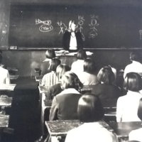 Sandra Nathan teaches a class in South Korea in the late 1960s as a Peace Corps volunteer. | SANDRA NATHAN / VIA THE NEW YORK TIMES