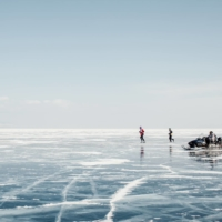 People run in the Baikal Ice Marathon on the frozen surface of Lake Baikal in Russia in March 2019.  | EMILE DUCKE / THE NEW YORK TIMES