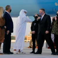 The UAE's Protocol Chief, Shihab al-Faheem, greets  U.S. Secretary of State Mike Pompeo with an elbow-bump at Al-Bateen Executive Airport in Abu Dhabi on Friday. | POOL / VIA AFP-JIJI
