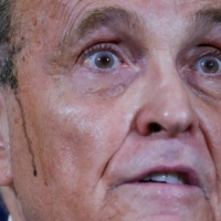 Former New York City Mayor Rudy Giuliani, personal attorney to U.S. President Donald Trump, speaks as sweat runs down his cheek during a news conference in Washington on Thursday. | REUTERS
