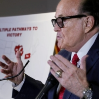 Former New York City Mayor Rudy Giuliani, personal attorney to U.S. President Donald Trump, speaks during a news conference in Washington on Thursday. | REUTERS