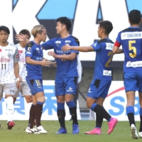 Oita puts Kawasaki's title celebrations on hold