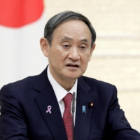 Suga says Japan to lead international efforts on climate change