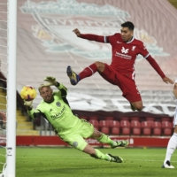 Liverpool's Roberto Firmino misses a chance to score during his team's match against Leicester on Sunday in Liverpool, England. | AP