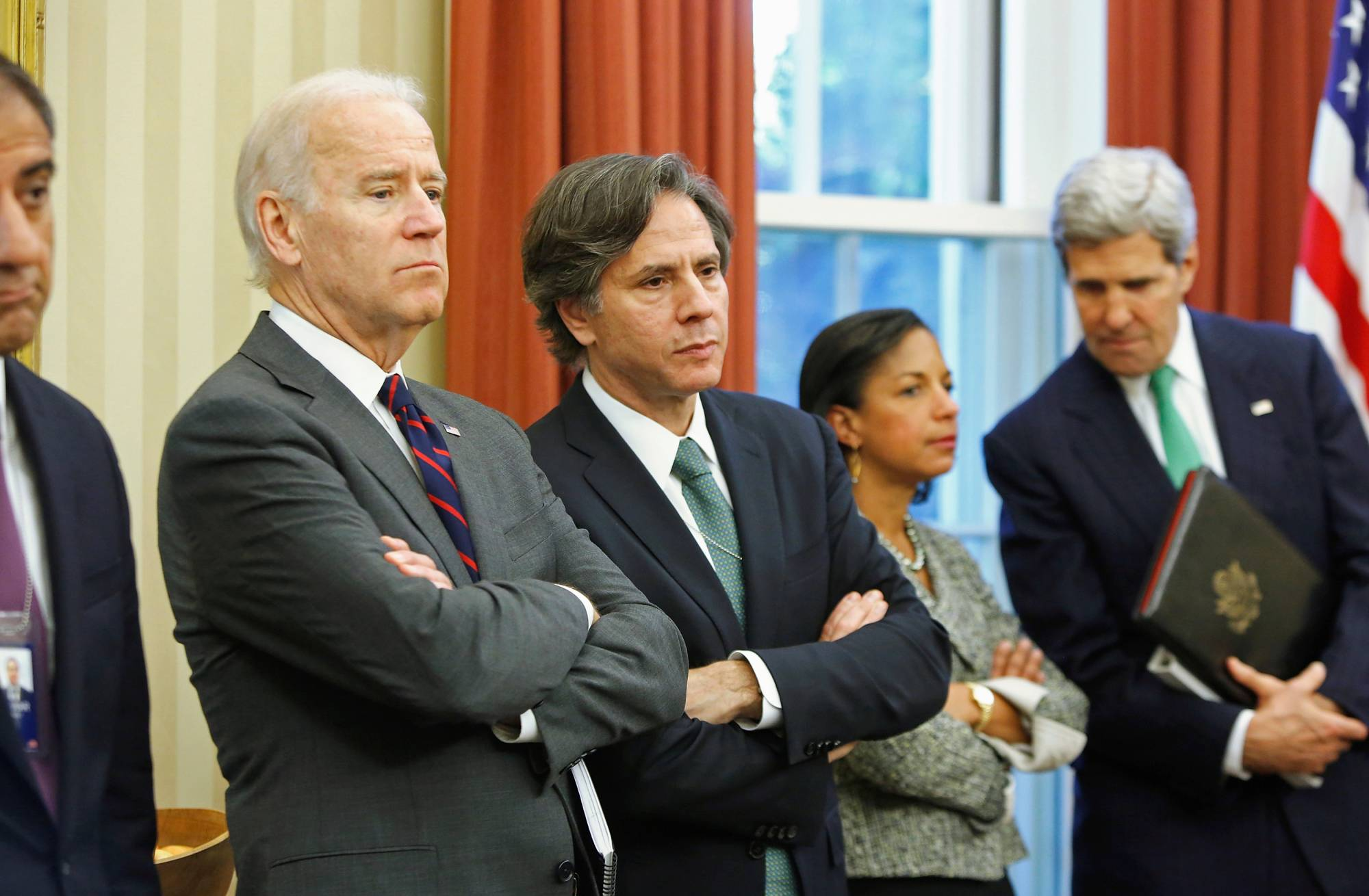 U.S. Vice President Joe Biden stands next to deputy national security adviser Antony Blinken during an event at the White House in November 2013. | REUTERS