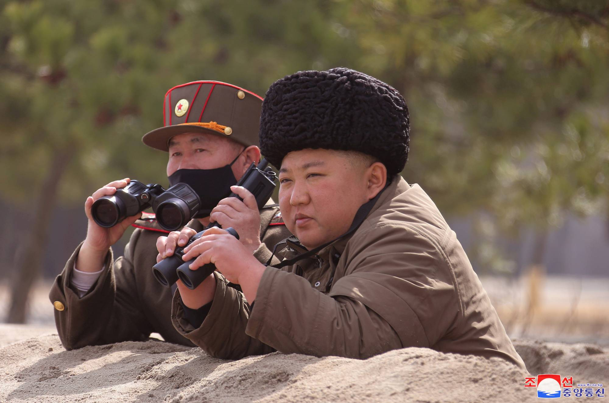 North Korean leader Kim Jong Un observes a weapons test in this undated picture released in March. | KCNA / VIA REUTERS