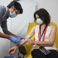 A volunteer is administered the coronavirus vaccine developed by AstraZeneca and Oxford University, in Oxford, England. | UNIVERSITY OF OXFORD / VIA AP