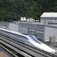 A maglev train travels along on a track during a trial run at the Yamanashi Maglev Test Track site in Tsuru, Yamanashi Prefecture.  | BLOOMBERG