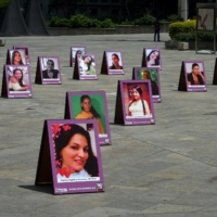 Ahead of the International Day for the Elimination of Violence on Nov. 25, portraits of victims of femicide were displayed in Medellin, Colombia. | AFP-JIJI