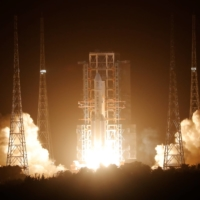 A Long March-5 rocket carrying the Chang'e-5 lunar probe takes off from the Wenchang Space Launch Center in Wenchang, in China's Hainan province, on Tuesday.  | REUTERS
