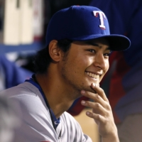 Rangers pitcher Yu Darvish of Japan smiles during a game against the Angels on April 24, 2013, in Anaheim, California. | REUTERS