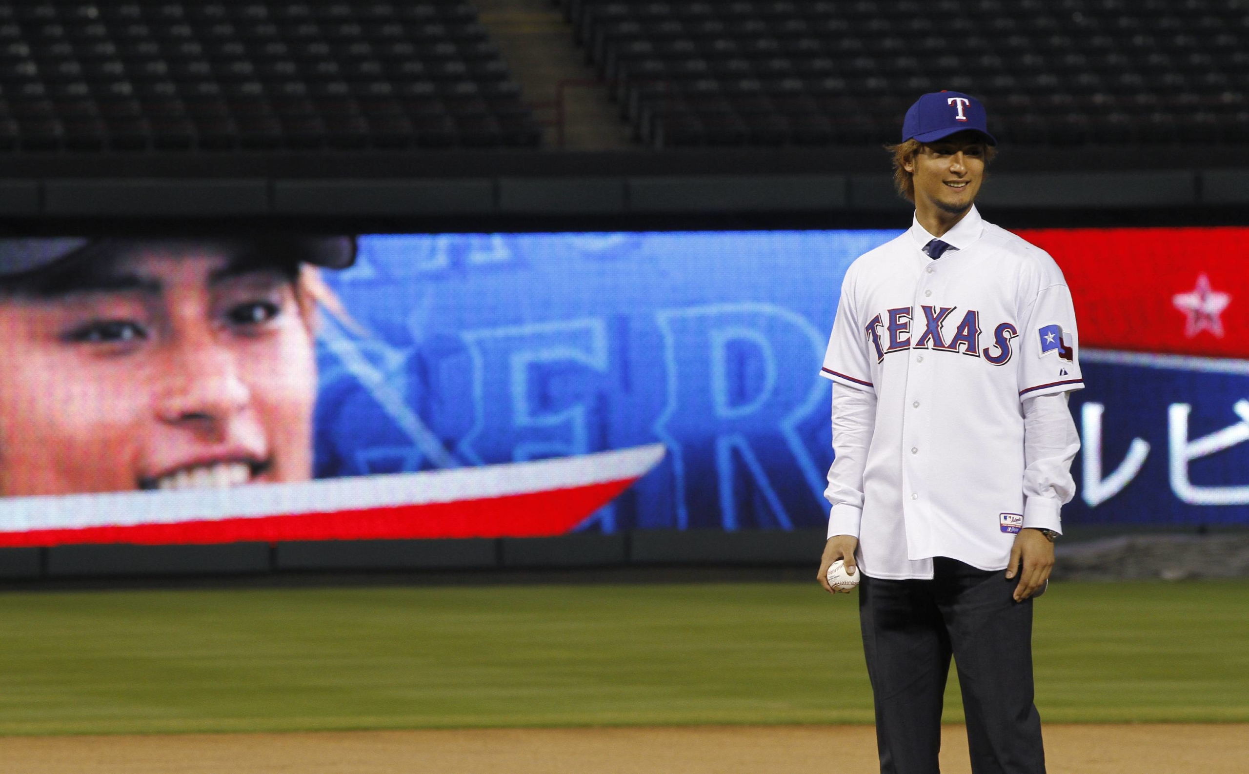 Yu Darvish takes the mound during his unveiling by the Rangers on Jan. 20, 2012, in Arlington, Texas. | REUTERS