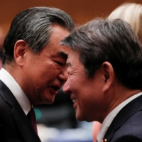Chinese Foreign Minister Wang Yi (left) talks to his Japanese counterpart, Toshimitsu Motegi, during the Group of 20 Foreign Ministers' Meeting in Nagoya in November last year. | REUTERS