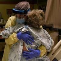 Health care personnel prepare to discharge a patient who had been quarantining after a possible exposure to COVID-19, at a hospital in Lakin, Kansas. | REUTERS