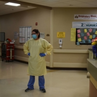 A health care worker takes a breather at a hospital in Lakin, Kansas. | REUTERS