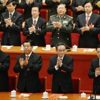 Xi Jinping (front left) replaced Hu Jintao (front right) as head of the Chinese Communist Party during the 18th National Congress of the party in November 2012. | KYODO