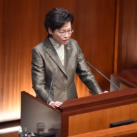 Hong Kong Chief Executive Carrie Lam delivers her annual policy address at the Legislative Council in Hong Kong on Wednesday.  | AFP-JIJI