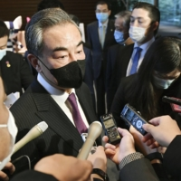 Wang Yi, China's foreign minister, speaks to the media at the Prime Minister's Office in Tokyo on Wednesday. | KYODO