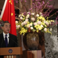 Wang Yi, China's foreign minister, speaks during a news conference in Tokyo on Tuesday. | REUTERS