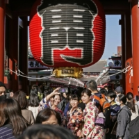 People visit Tokyo's Asakusa district on Sunday during the three-day holiday. | KYODO