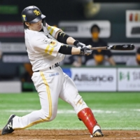 The Hawks' Takuya Kai connects on a two-run home run against the Giants during the second inning on Wednesday in Fukuoka.  | KYODO