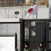 Paramilitary policemen stand guard in front of the Japanese Embassy in Beijing in December 2013.  | REUTERS