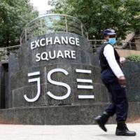 People walk past the Johannesburg Stock Exchange in Sandton, South Africa, on Nov. 9. Africa has held off the COVID-19 assault better than many developing regions, with seven of its 54 countries now among the globe's 10 fastest-growing economies. | REUTERS