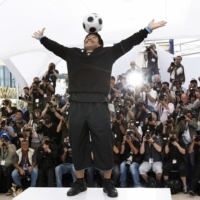 Maradona poses during the photo call for the documentary 'Maradona' during the 61st International film festival in Cannes, southern France, in 2008.  | AP