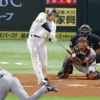 Yuki Yanagita homers against the Giants in Game 4 of the Japan Series on Wednesday. | KYODO