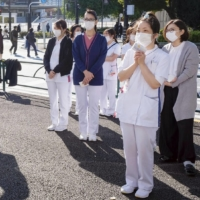 Medical workers stage a rally in Tokyo to call for the government's financial support for medical institutions amid the coronavirus pandemic. | KYODO